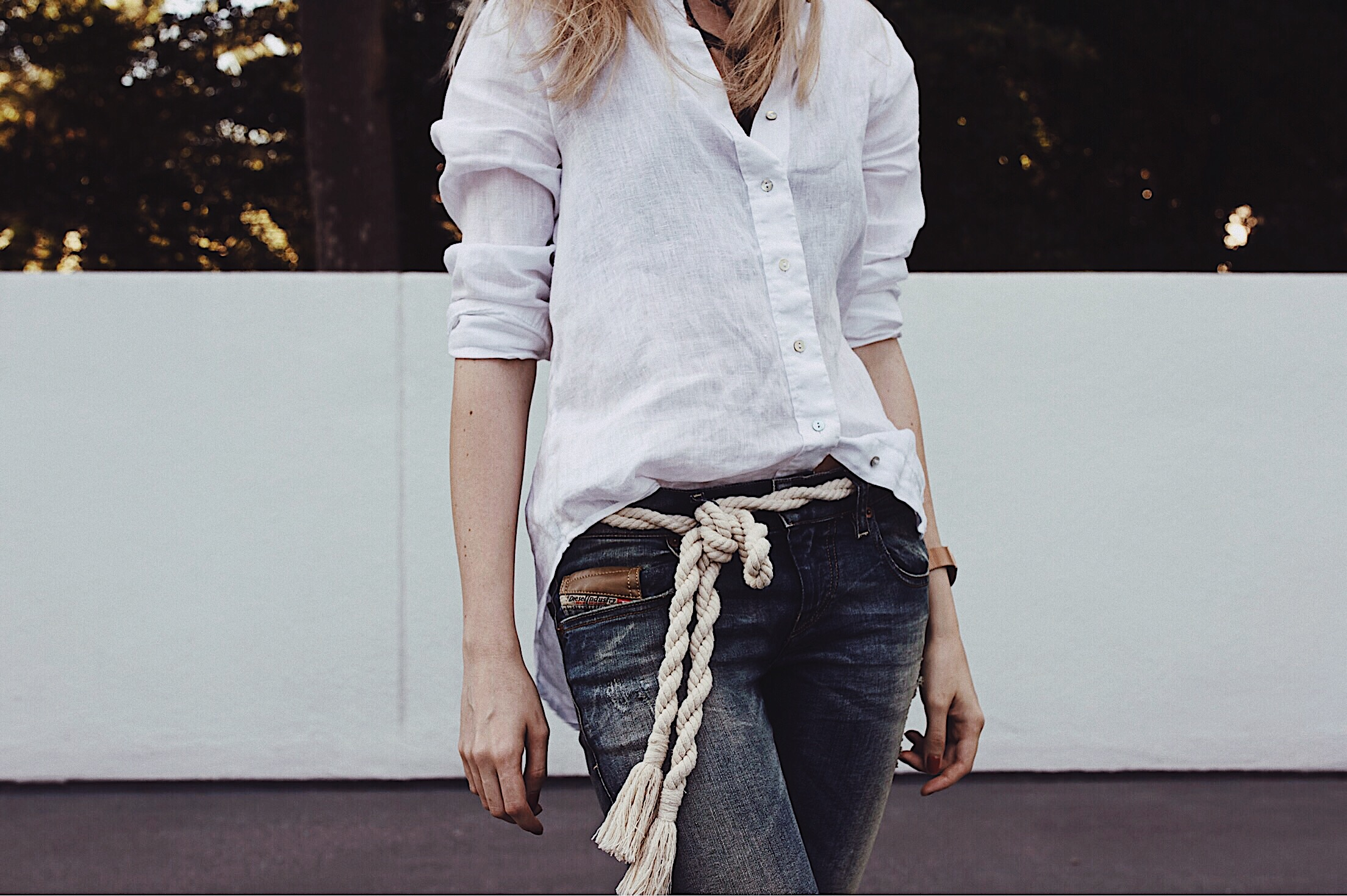 Crisp white linen shirt and rope belt