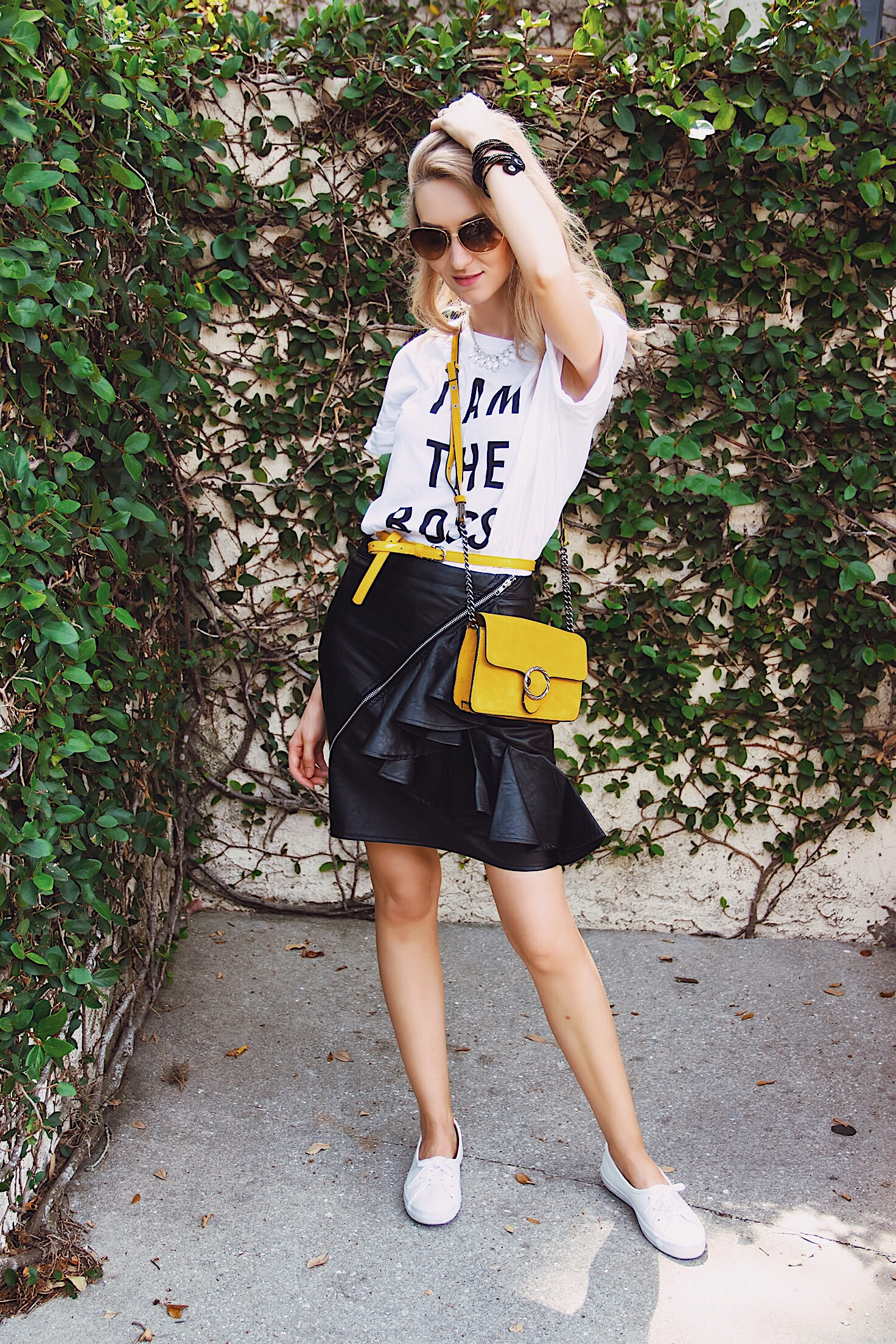 I Am The Boss Graphic Tee Faux Leather Ruffle Skirt Suede Mustard Bag White Lacoste Sneakers
