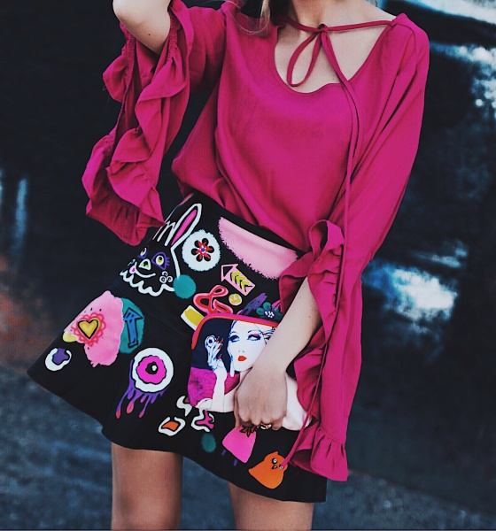 Vibrant Spring: Magenta Ruffle Top and Graffiti Leather Skirt