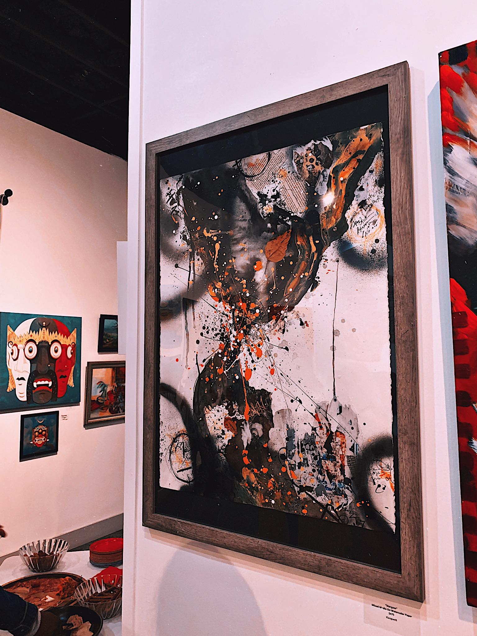Stargaze - mixed media painting hanging at art gallery